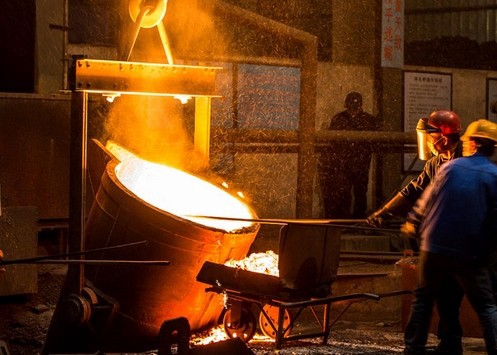 men working investment casting foundry